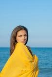 Young sad girl near sea on sunset Stock Image