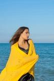 Young sad girl near sea on sunset Royalty Free Stock Photos