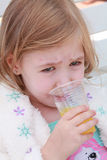Young sad girl with orange juice, isolated on white Royalty Free Stock Photography