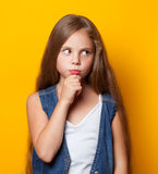 Young sad girl. On yellow background Stock Images
