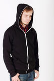 Young sad handsome man in black hoodies and jeans Royalty Free Stock Photo