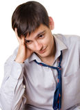 Young sad man. In blue tie on white background Royalty Free Stock Photo