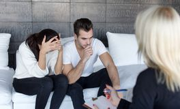 Young sad man and woman on couple therapy Stock Image