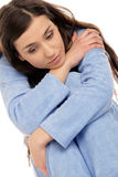 Young sad woman. Portrait of young sad woman wearing blue pajamas Royalty Free Stock Photos