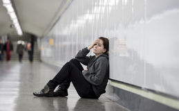 Young sad woman in pain alone and depressed at urban subway tunn Royalty Free Stock Photo