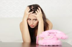 Young sad woman with phone Royalty Free Stock Image