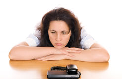 Young sad woman with phone Royalty Free Stock Photography