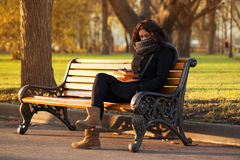 Young sad woman sitting alone Royalty Free Stock Image