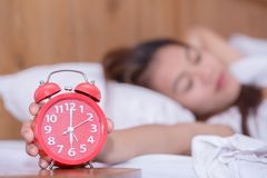 Young sad woman suffering insomnia and sleeping disorder proble royalty free stock image