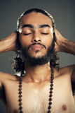 Young sadhu relaxing Stock Images