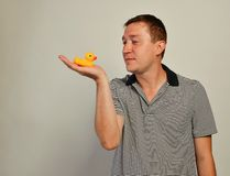 Young  man  with a duck toy Stock Images