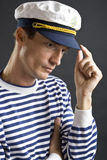 Young sailor man with white cap. Young sailor man with white sailor hat Royalty Free Stock Photo