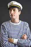 Young sailor man with white cap. Young sailor man with white sailor hat Royalty Free Stock Photography