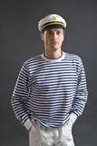 Young sailor man with white sailor hat. On gray background Stock Image