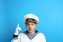 Young sailor. Posing on a blue background Stock Image