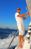 Young Sailor relaxing happily on the vacation sailboat yach Stock Photo