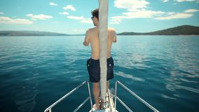 Young Sailor relaxing on the vacation sailboat yacht stock footage