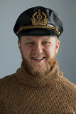 The young sailor's cap. And a brown knit sweater Stock Image