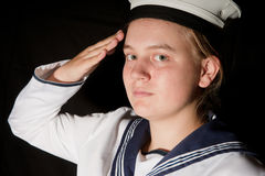 Young sailor saluting isolated white background. Young female sailor saluting isolated on black Stock Photography