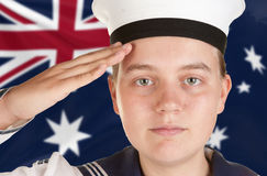 Young sailor saluting isolated white background. Young female sailor saluting in front of australian flag Royalty Free Stock Photos