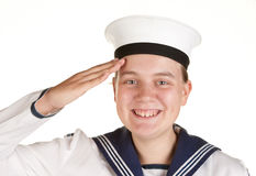 Young sailor saluting isolated white background. Young female sailor saluting isolated on white Stock Photo