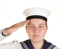 Young sailor saluting isolated white background. Young female sailor saluting isolated on white Royalty Free Stock Photography