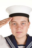 Young sailor saluting isolated white background. Young female sailor saluting isolated on white Royalty Free Stock Image