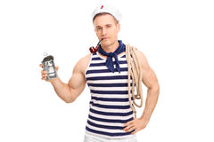 Young sailor smoking tobacco and holding an empty can Stock Images