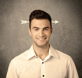 Young sales guy with arrow in the head Royalty Free Stock Photography
