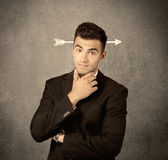 Young sales guy with arrow in the head Stock Photo