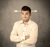 Young sales guy with arrow in the head Royalty Free Stock Image