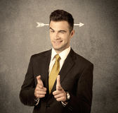 Young sales guy with arrow in the head Stock Photography