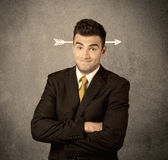 Young sales guy with arrow in the head Royalty Free Stock Images