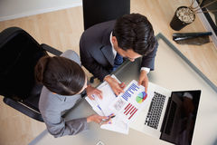 Young sales persons studying statistics Royalty Free Stock Photography