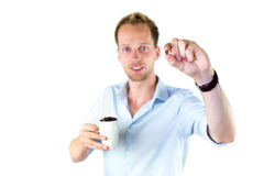 Young salesman holding cup and coffee beans Stock Photography