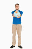 Young salesman presenting globe with his hands Royalty Free Stock Photos