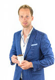 Young salesman promoting coffee beans in cup Stock Image