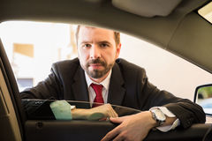 Young salesman ready to sell this car Royalty Free Stock Photo