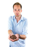 Young salesman showing hands full with coffee beans Stock Photography