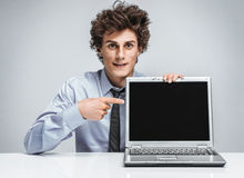 Young salesman showing at screen laptop. / modern businessman at the workplace working with computer royalty free stock image