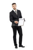 Young salesman in suit pointing signature space with pencil offering contract Stock Images