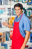 Young Salesman Welcoming At Hardware Shop Stock Photos