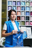 Young salesperson girl at clothes shop Royalty Free Stock Images