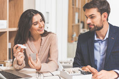 Young saleswoman proposing design product to buyer Royalty Free Stock Image