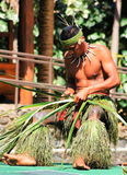 A young Samoan man demonstrating the art of weaving. Honolulu, Hawaii - May 27, 2016:A young Samoan man demonstrating the art of weaving in the Village of Samoa stock image