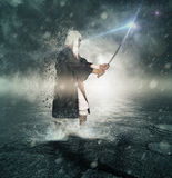 Young samurai combat ready. Young samurai with his magic saber for the fight Royalty Free Stock Images