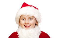 Young santa claus child with fur cap smiles happy Royalty Free Stock Photography