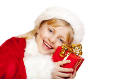 Young santa claus girl holds christmas gift Stock Image