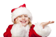 Young santa claus girl holds palm for ad space Royalty Free Stock Photos
