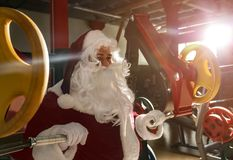 Free Young Santa Claus Training In Gym Royalty Free Stock Photo - 160575035